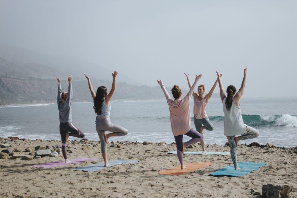women-yoga-on-beach-kaylee-garrett