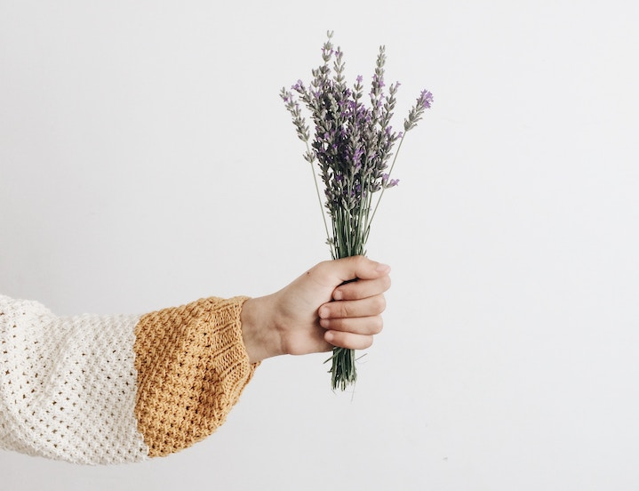 Woman holding lavender flowers