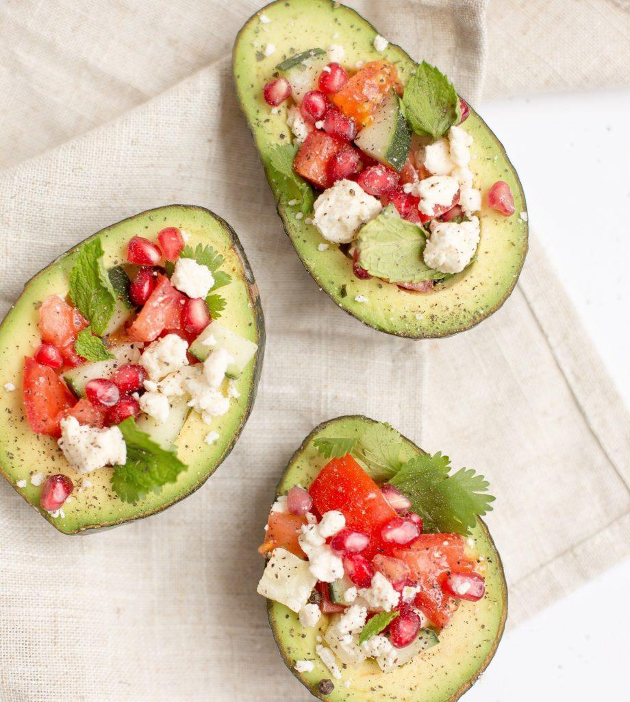 feta and pomegranate avocados